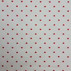 Piqué de coton motif petits coeurs