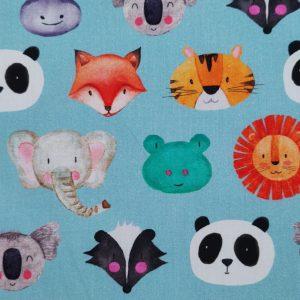Coton imprimé fond bleu motif têtes d'animaux