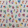 coton, imprimé, lettre de l'alphabet, animaux, étoile, lune, glace, arbre, instrument, jaune, vert, violet, bleu, orange, rouge, rose