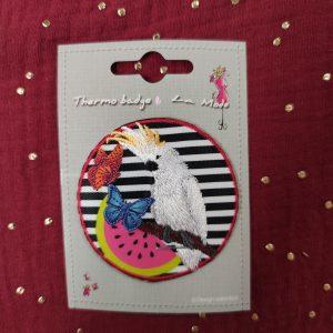 Badge écusson thermocollant perroquet fond zèbre
