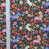 coton imprimé d'un champ de fleurs et de licornes colorées